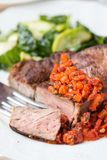 Grilled beef steak with salsa sauce dried tomatoes, red peppers Royalty Free Stock Image
