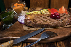 Grilled beef steak. With sauce and vegetables Stock Images