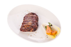 Grilled beef steak with seasoning Royalty Free Stock Image