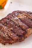 Grilled beef steak with seasoning Royalty Free Stock Photos