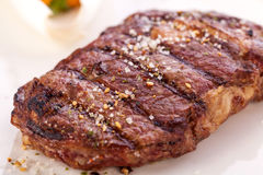 Grilled beef steak with seasoning Royalty Free Stock Photo