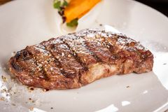 Grilled beef steak with seasoning Stock Images