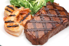Grilled beef steak and shrimps Stock Photography