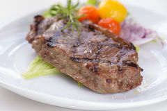 Grilled beef steak with some vegetables Royalty Free Stock Image