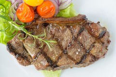 Grilled beef steak with some vegetables Royalty Free Stock Photos