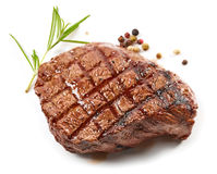 Grilled beef steak. And spices isolated on white background Royalty Free Stock Images