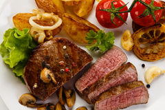 Grilled beef steak. S with boiled potatoes and vegetables Stock Photos
