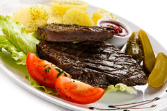 Grilled beef steak. S with boiled potatoes and vegetables Stock Images
