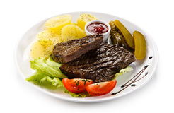 Grilled beef steak. S with boiled potatoes and vegetables Royalty Free Stock Photos