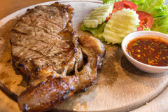 Grilled beef steak. And tomato , lettuce Stock Images