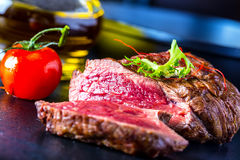 Grilled Beef steak with vegetable decoration. Grilled porterhouse steak on slate board. Food collection stock photography