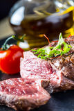 Grilled Beef steak with vegetable decoration. Grilled porterhouse steak on slate board. Stock Image