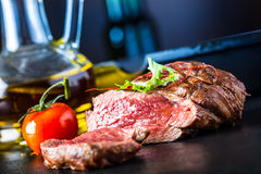 Grilled Beef steak with vegetable decoration. Grilled porterhouse steak on slate board. Royalty Free Stock Photography