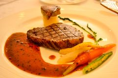 Grilled beef steak with vegetables as a side dish royalty free stock photography