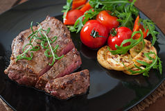 Grilled beef steak with vegetables Royalty Free Stock Photo