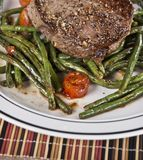 Grilled Beef Steak with vegetables. Grilled Beef Steak with green beans and tomatoes stock photo