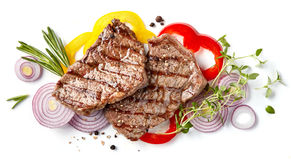 Grilled beef steak. And vegetables isolated on white background, top view royalty free stock photo