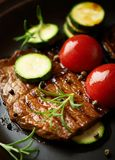 Grilled beef steak with vegetables . royalty free stock photography