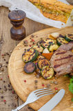 Grilled beef steak. With vegetables on the wooden plate Royalty Free Stock Photography