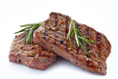 Grilled beef steak. On a white background Royalty Free Stock Photos