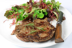 Grilled beef steak. On a white background Stock Image