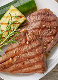 Grilled beef steak on white plate Royalty Free Stock Photo
