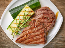 Grilled beef steak on white plate Royalty Free Stock Image