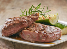 Grilled beef steak on white plate royalty free stock photos