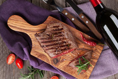 Grilled beef steak and wine Royalty Free Stock Images
