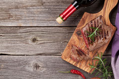 Grilled Beef Steak With Rosemary, Salt And Pepper And Wine Stock Photos