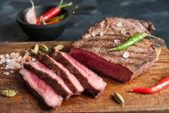 Grilled beef steak on wooden board royalty free stock images