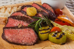 Grilled beef steak on wooden board Stock Photography