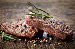 Grilled beef steak. On wooden cutting board Royalty Free Stock Images