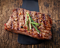 Grilled beef steak. On wooden cutting board Stock Photography