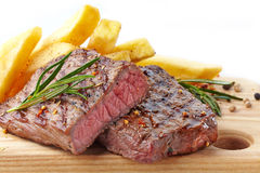 Grilled beef steak. On wooden cutting board Stock Image