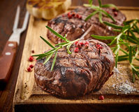 Grilled beef steak. On wooden cutting board Stock Photo