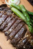 Grilled beef steak on a wooden rustic background stock image