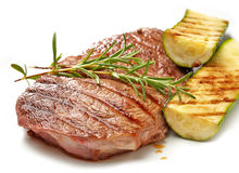 Grilled beef steak and zucchini. On white background Royalty Free Stock Image