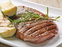 Grilled beef steak and zucchini Royalty Free Stock Photography
