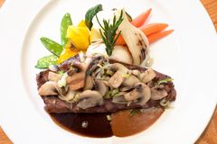 Grilled Beef Steaks with Mushrooms Royalty Free Stock Photography