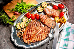 Grilled beef steaks on platter Royalty Free Stock Photography