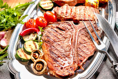 Grilled beef steaks on platter Stock Photography