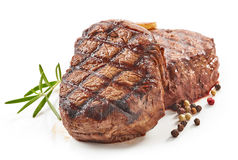 Grilled beef steaks Stock Photos
