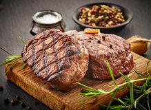 Grilled beef steaks stock photography