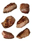 Grilled beef steaks in various kinds, collection on white background royalty free stock photo