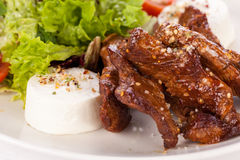 Grilled beef stripes fresh salad and goat cheese Stock Image