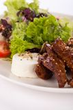 Grilled beef stripes fresh salad and goat cheese Royalty Free Stock Image