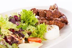Grilled beef stripes fresh salad and goat cheese Royalty Free Stock Photography