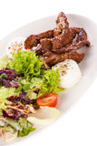 Grilled beef stripes fresh salad and goat cheese Royalty Free Stock Images