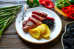 Grilled beef tenderloin with french fries Stock Photo